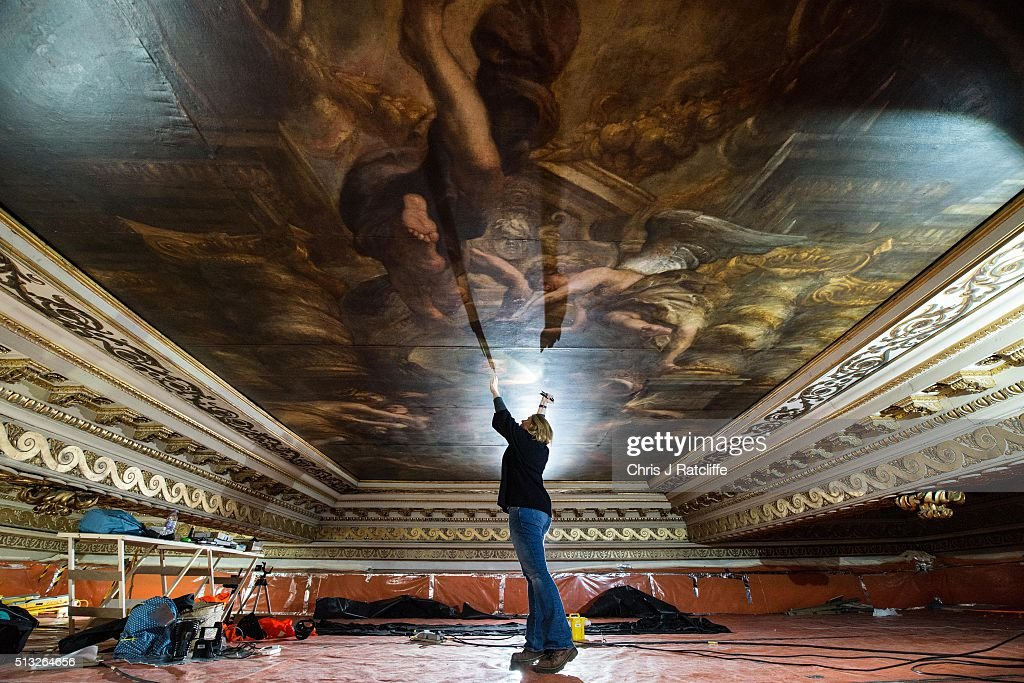 Conservationist Sarah Pinchin, 41, inspects her teams work on Rubens ceiling painting 'Wise rule of James 1st' and shines a light on an image of James 1st during restoration work at Banqueting House on March 1, 2016 in London, England. The Banqueting House is the only remaining part of the Palace of Whitehall, once the largest Palace in Europe but destroyed by fire in 1698. Visitors can see the magnificent ceiling painted by Sir Peter Paul Rubens. It is currently being renovated and will re-open to the public on April 1st.