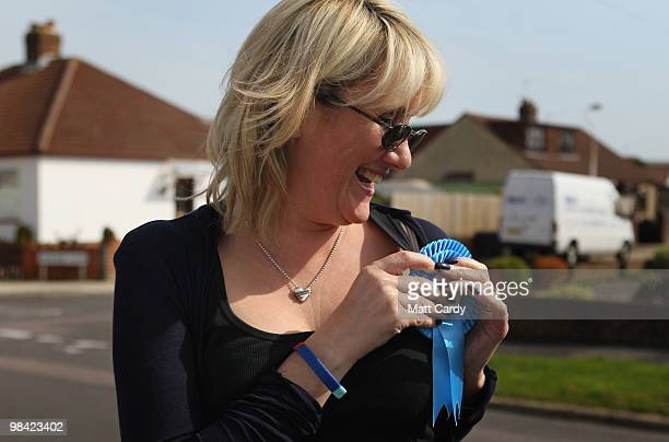 Conservative candidate Caroline Dinenage adjusts her rosette as she campaigns in the constituency of Gosport in Hampshire on April 10 2010 in Gosport...