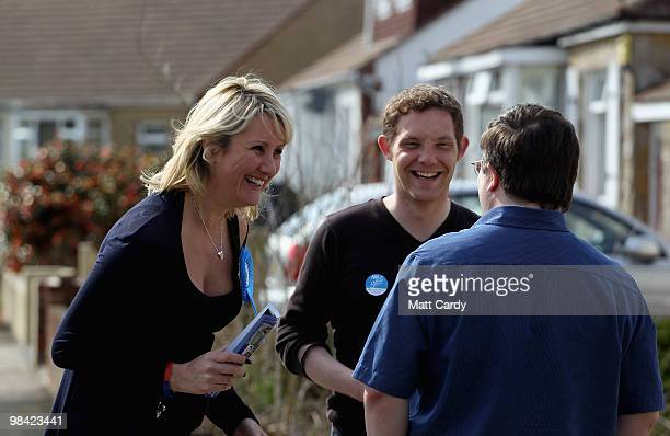 Conservative candidate Caroline Dinenage talks with a potential voter on the doorstep as she campaigns in the constituency of Gosport in Hampshire on...