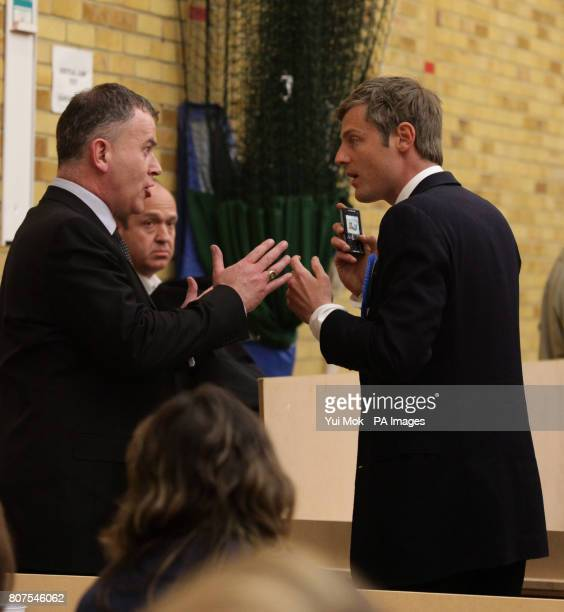 Conservative candidate Zac Goldsmith is told not to use his mobile phone in the counting hall by a press officer at the General election count for...