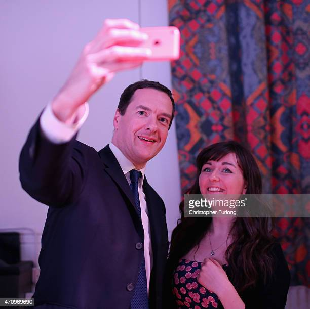 Conservative Chancellor George Osborne takes a selfie with a member of the audience after an election hustings event for the Tatton constituency at...