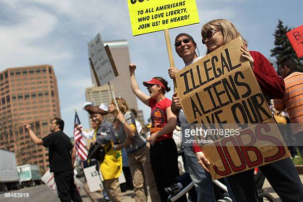 Conservative demonstrators argue against illegal immigration at a 'Tax Day Tea Party' protest at the state capitol building on April 15 2010 in...