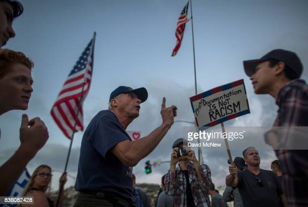 Conservative demonstrators argue at someone questioning their cause at an 'America First' demonstration on August 20 2017 in Laguna Beach California...