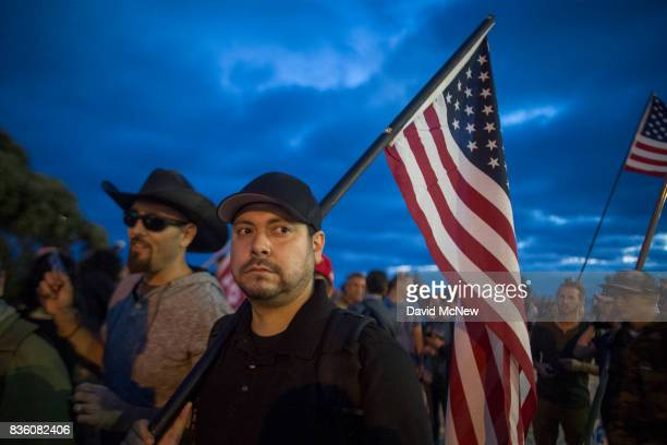 Conservative demonstrators rally at an 'America First' demonstration on August 20 2017 in Laguna Beach California Organizers of the rally describe it...