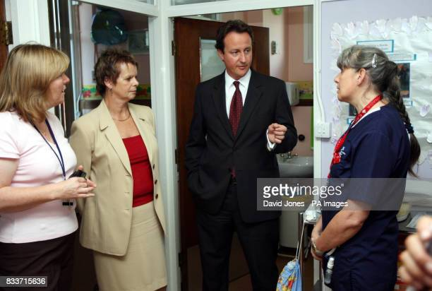 Conservative leader David Cameron accompanied by Shadow Health spokesperson Ann Milton talks to staff Anne Haines and Karen Hin during a visit to the...