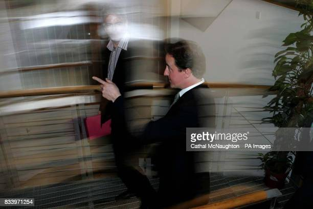 Conservative leader David Cameron arrives at the launch of the Conservative Party's policy paper on decentralised energy entitled 'Power to the...