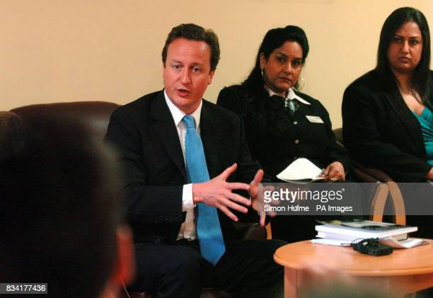 Conservative leader David Cameron chats about forced marriages with Surinder Singh and Hema Nar from the ANAH Project at Mary SeaCole House in...