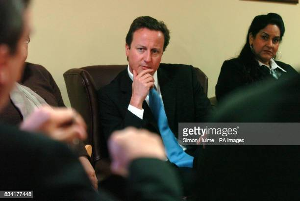 Conservative leader David Cameron chats about forced marriages with Surinder Singh from the ANAH Project at Mary SeaCole House in Bradford