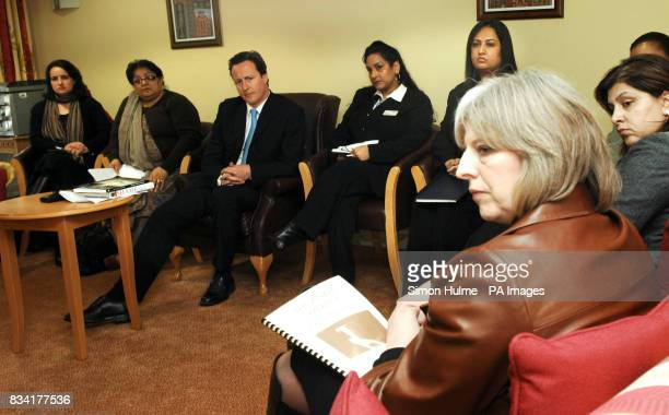 Conservative leader David Cameron chats with Theresa May and members of the ANAH Project at Mary SeaCole House in Bradford