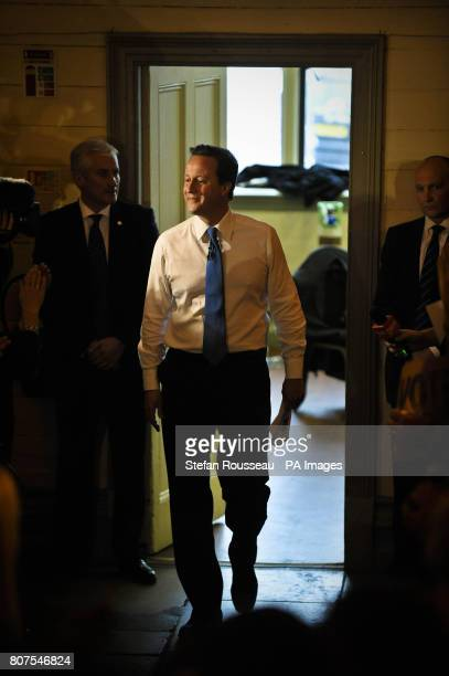 Conservative leader David Cameron exits his green room to go under the spotlight and take centre stage to give a speech during a rally of supporters...