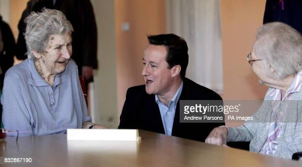 Conservative leader David Cameron talks to patients in the rehabilitation unit during a visit to the Princess of Wales Memorial Hospital in Ely where...