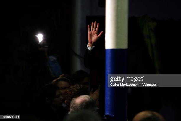 Conservative leader David Cameron waves to the assembled audience as he launches the Conservative Party's policy paper on decentralised energy...
