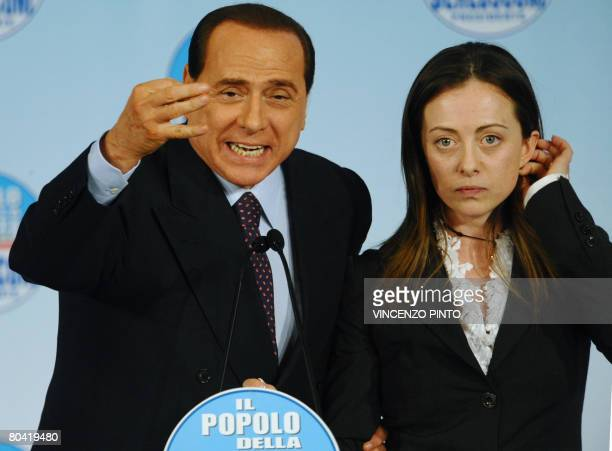 Conservative leader Silvio Berlusconi and National Alliance member and vicepresident of the Chambers of Deputies Giorgia Meloni hold an election...