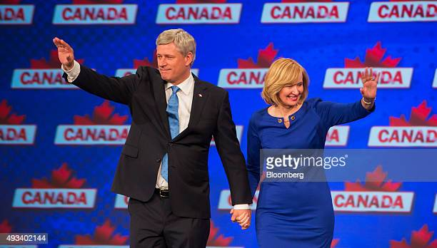 Conservative Leader Stephen Harper Canada's prime minister waves with his wife Laureen Harper during a news conference where he conceded victory on...