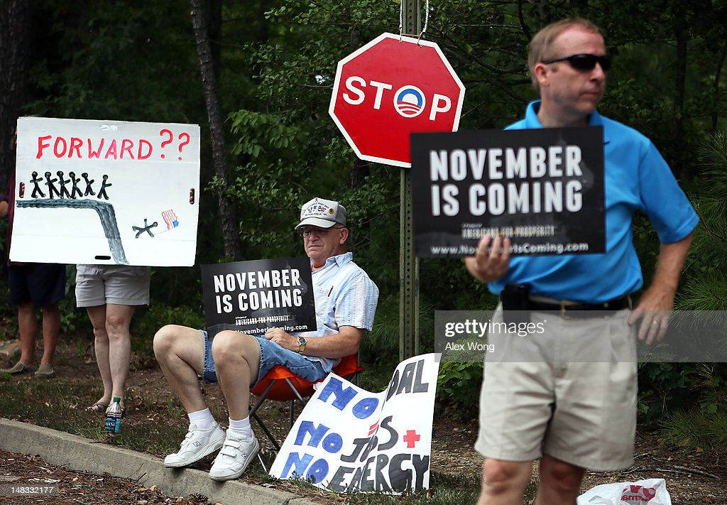 Conservative local residents protest prior to U.S. President Barack Obama's ''A Vision for Virginia's Middle Class'' campaign event July 14, 2012 at Walkerton Tavern in Glen Allen, Virginia. On the last day of his two-day campaign across Virginia, Obama continue to discuss his plan to restore middle class security and urged the Congress to act on extending tax cuts to middle class families.