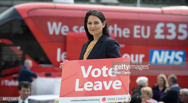 Conservative MP and Minister of State for Employment Priti Patel holds a Vote Leave poster as she joins the Vote Leave battle bus tour as it stops in...