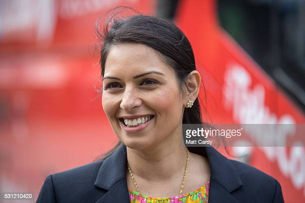 Conservative MP and Minister of State for Employment Priti Patel stands beside the Vote Leave battle bus as it stops in Portsmouth on May 13 2016 in...