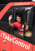 Conservative MP and Minister of State for Employment Priti Patel sits behind the wheel of the Vote Leave battle bus as it stops in Portsmouth on May...