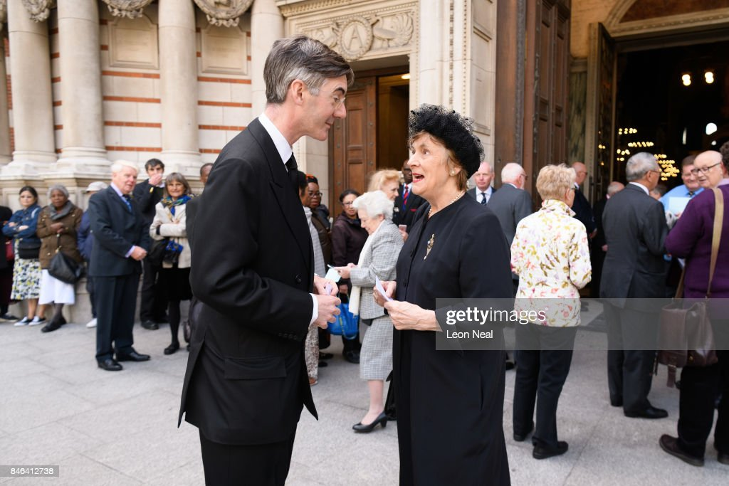 Conservative MP for North East Somerset Jacob Rees-Mogg (L) talks with his mother as they arrive at Westminster Cathedral for the funeral of the late British Cardinal Cormac Murphy-O'Connor, on September 13, 2017 in London, England. The 85-year-old died on September 1 after a battle with cancer.
