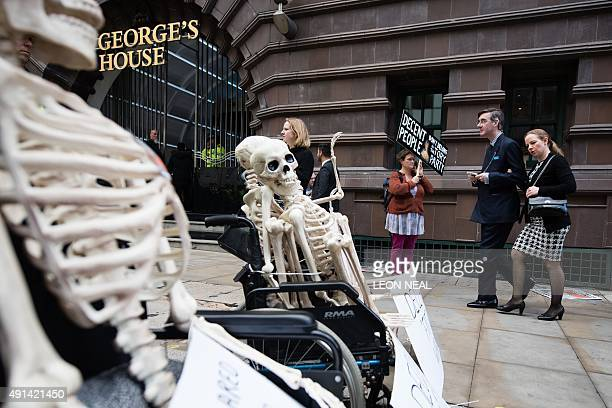 Conservative MP Jacob ReesMogg walks outside the secure cordon past a protest calling for an end to cuts to the National Health Service on the second...