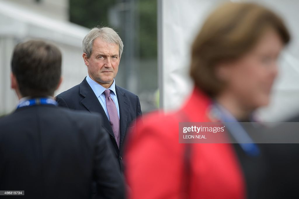 Conservative MP Owen Paterson is interviewed outside the venue of the Conservative Party conference in Birmingham in central England on September 29...