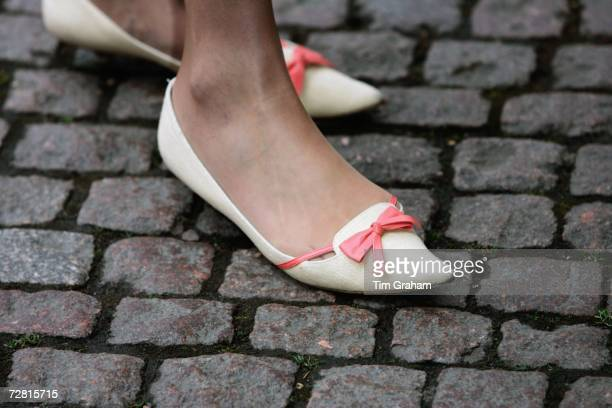 Conservative MP Theresa May wears flat shoes with a bow to the Children of Courage Awards at Westminster Abbey on December 13 2006 in London England