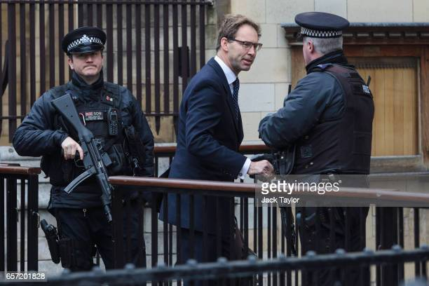 Conservative MP Tobias Ellwood shakes hands with an armed officer as he enters the Houses of Parliament on March 24 2017 in London England Mr Ellwood...