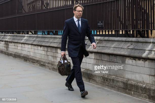 Conservative MP Tobias Ellwood walks past the Houses of Parliament on March 24 2017 in London England Mr Ellwood was pictured giving first aid to PC...