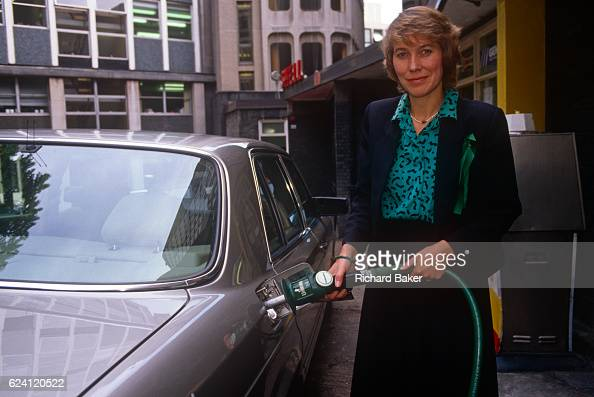 Conservative MP Virginia Bottomley fills a car with unleaded fuel during Lead free Petrol Week in September 1989 London England Virginia Hilda...