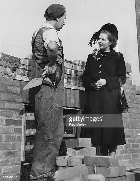 Conservative Parliamentary candidate Margaret Thatcher nee Roberts talking to a bricklayer John Hayes during a canvassing tour in her constituency of...