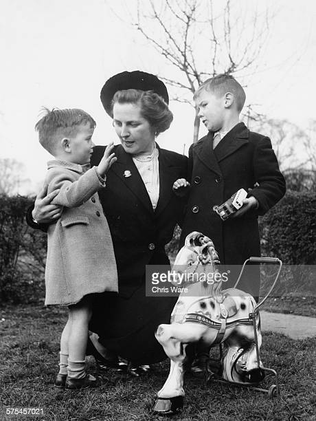 Conservative Parliamentary candidate Margaret Thatcher nee Roberts talking to young boys Ricky and Jamie Miller as she canvasses for votes in her...
