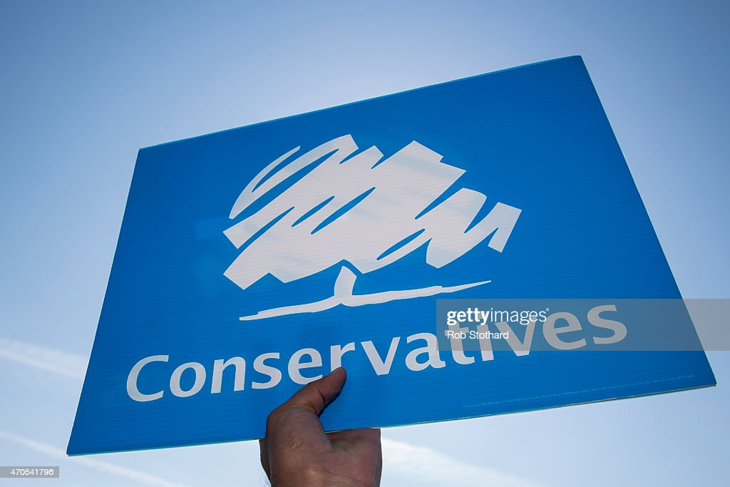 Conservative party activists holds a party placard whilst onboard the Jackie DoylePrice incumbent MP for Thurrock constituency battle bus on April 21...