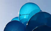 Conservative party balloons are held aloft by campaign workers on October 20 2014 in Rochester England An open postal primary vote will decide the...