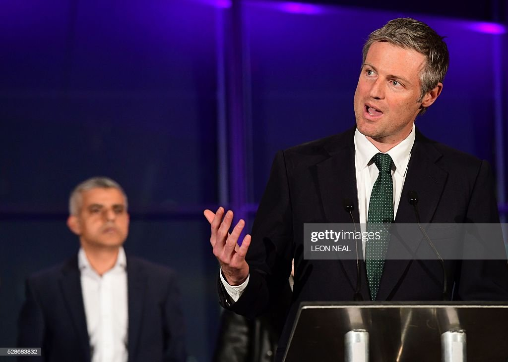 Conservative party candidate for London Mayor, Zac Goldsmith, (R) addresses the media as newly elected mayor of London Sadiq Khan looks on during the declaration at City Hall in central London on May 7, 2016. London became the first EU capital with a Muslim mayor Friday as Sadiq Khan won the election that saw his opposition Labour party suffer nationwide setbacks. / AFP / LEON