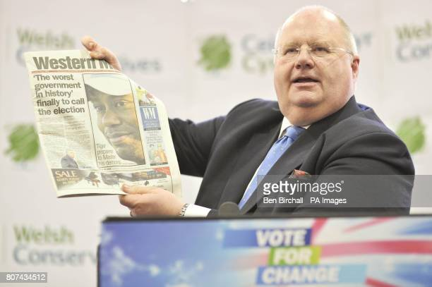 Conservative Party chairman Eric Pickles MP holds a copy of the Western Mail newspaper which carried the headline ''The worst Government in history'...