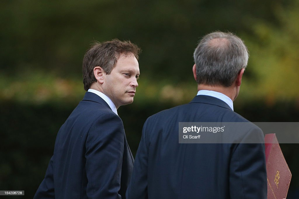 Conservative Party Co-Chairman Grant Shapps (L) leaves Downing Street after attending the weekly Cabinet meeting on October 16, 2012 in London, England.