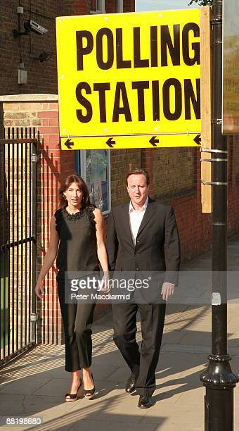 Conservative Party leader David Cameron and his wife Samantha attend a local polling station to cast their votes in the European elections on June 4...