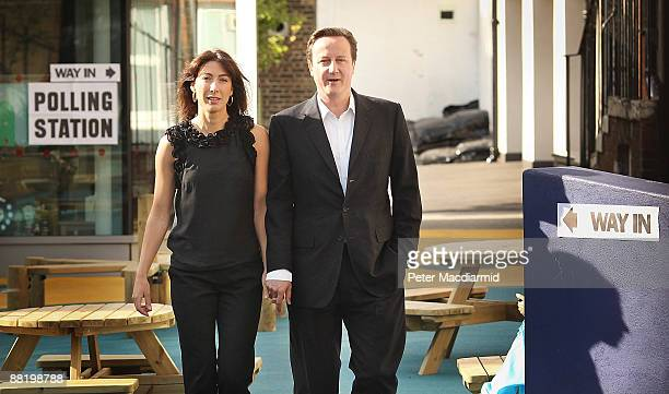 Conservative Party leader David Cameron and his wife Samantha leave a local polling station after casting their votes in the European elections on...