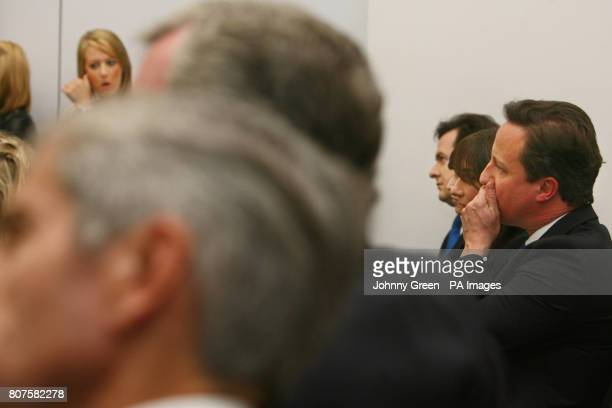 Conservative Party leader David Cameron and his wife Samantha Shadow Chancellor George Osborne and boss of Marks Spencer Sir Stuart Rose listen to an...
