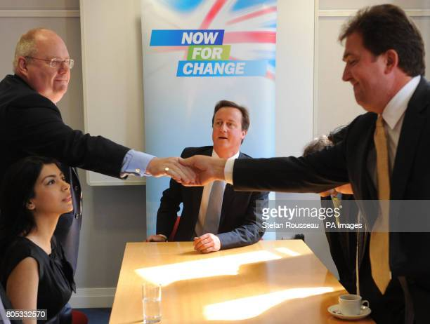 Conservative Party leader David Cameron and party chairman Eric Pickles meet former Liberal Democrat party candidates in London who have defected to...