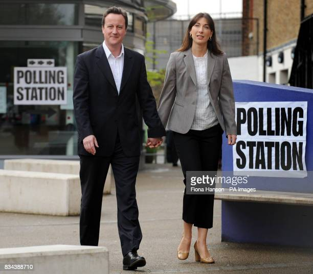 Conservative Party leader David Cameron and wife Samantha depart a polling station in Notting Hill West London after casting their votes in the local...