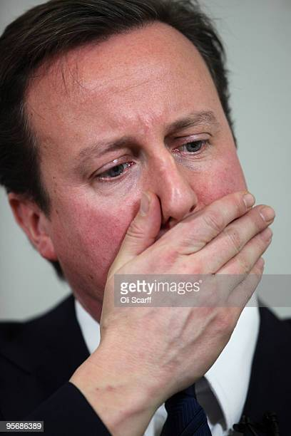 Conservative party leader David Cameron listens to audience questions after delivering a speech at the headquarters of the think tank DEMOS on...