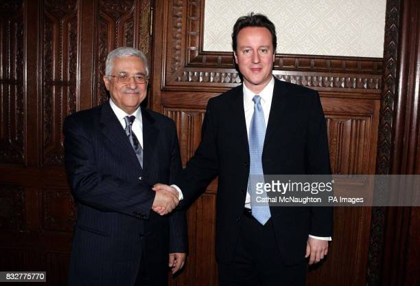 Conservative Party leader David Cameron meets Palestinian President Mahmoud Abbas in the Shadow Cabinet room at London's Portcullis House