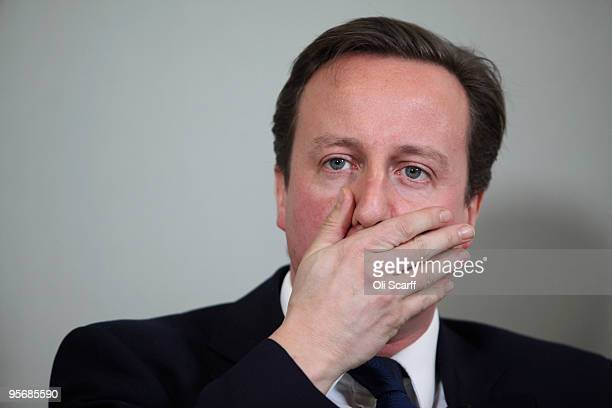 Conservative party leader David Cameron prepares to deliver a speech at the headquarters of the think tank DEMOS on January 11 2010 in London England...