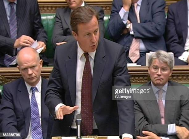 Conservative Party leader David Cameron reacts to the statement Prime Minister Gordon Brown made regarding the inquiry into the war in Iraq