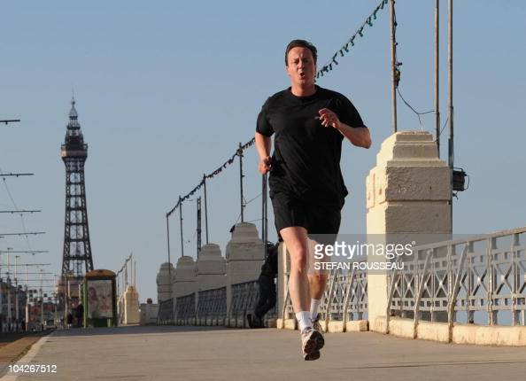Conservative Party leader David Cameron runs along the seafront in Blackpool on May 3 2010 Britain's party leaders pushed into the final days of...
