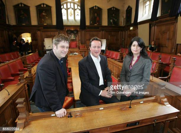 Conservative Party leader David Cameron sits inside Oxford Town Hall Oxford with local councillors Paul Sargent and Dr Tia McGregor