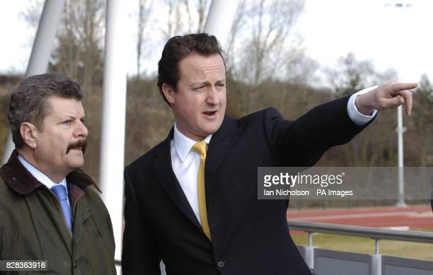 Conservative Party leader David Cameron talks with local councillor Ray Puddifoot in Uxbridge while on a tour of the constituency Thursday 2 March...