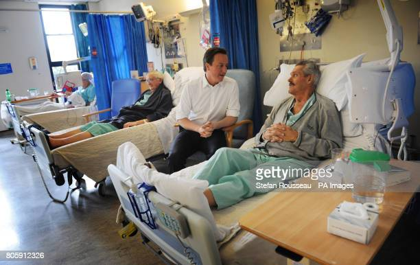 Conservative Party leader David Cameron visits patients on the cardiac ward of the Royal Sussex Hospital in Brighton today where his party have...