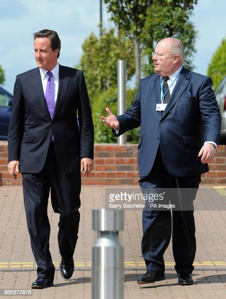 Conservative party leader David Cameron with Party Chairman Eric Pickles arrive at the Conservative Spring Forum in Cheltenham which Mr Cameron will...